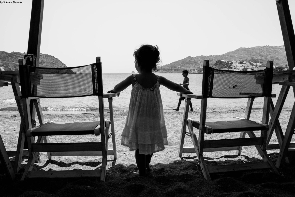 A little girl gazing the sea